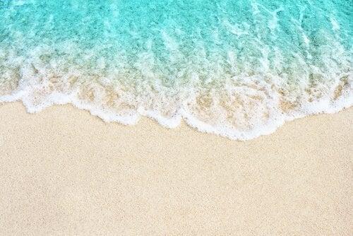 Metaforen om bølgene på stranden