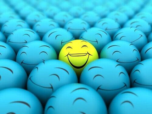 Kuler med glade og triste smilefjes