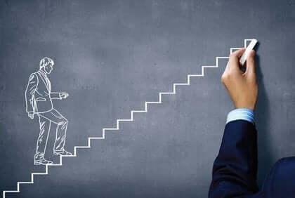 En person som tegner en mann som går opp trapper